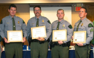 Four Michigan conservation officers were honored last week for their role in the search and rescue operation that eventually recovered Newaygo County toddler Amber Smith, who had been lost in the woods for nearly 24 hours in October 2013. Pictured here (L to R) are Officer Brian Lebel; Officer Mike Wells; Officer Jeff Ginn; and Sgt. Mike Bomay.
