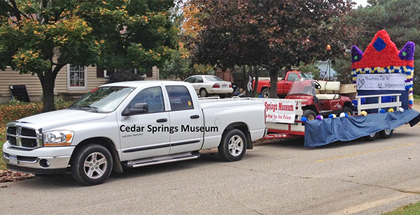 Pictured left is the 2014 Cedar Springs Museum float.