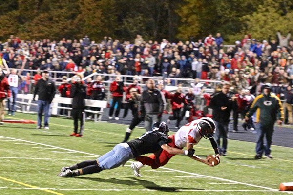 Red Hawk quarterback Collin Alvesteffer dives into the endzone with the game-winning touchdown. Photo by K. Alvesteffer.
