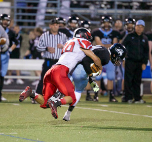 Red Hawk MavRick Cotten brings down the ball carrier. Photo by K. Alvesteffer.