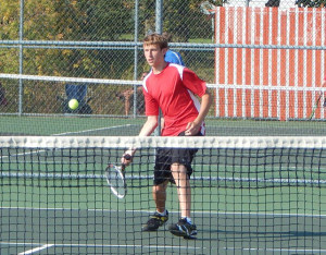 Red Hawk Dylan Kolasa, #4 singles, prepares to return the ball to his opponent's side of the court.