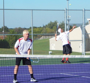 Karsen Dingman serving the ball and Austin Nielsen waiting for their opponent's return. The boys are the #1 doubles team for Cedar Springs and won both of their matches against Cadillac and Greenville last week.