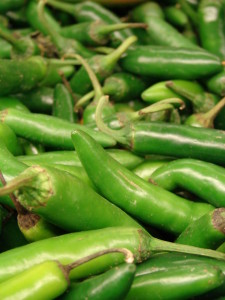 This photo shows unripe serrano peppers. They can be varying shades of green, red, orange or brown upon maturity.