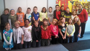 4th Grade – Ms. Norman's class with 1st place winner Rebekah Wineman standing next to Ms. Norman