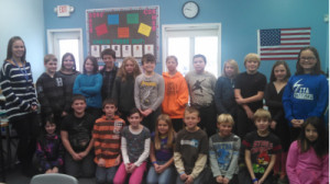 5th Grade – Mrs. Harwood's class with 1st place winner Nathan Fisk standing next to Mrs. Harwood