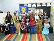 Second grade class showing their Charger spirit on Halloween