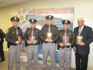 (L to R) Deputies Mike Stahl, Chad Tucker, Chad Potts, Ed Good and retired Chief Roger Parent. Post photo by J. Reed.