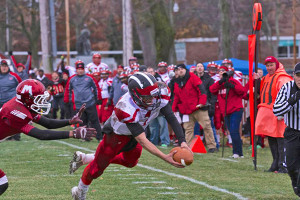 Quarterback Collin Alvesteffer scored both touchdowns against the Muskegon Big Reds. Photo by K. Alvesteffer.