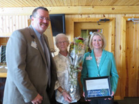 Joan Oberlin, center, is this year's recipient of the Suzanne Christensen Volunteer Award.