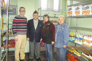 Pictured (from L to R) is Pastor Steve Lindeman, Commander Bill Gregones, food pantry volunteer Caroline Bartlett, and food pantry volunteer Sue Harrison. Post photo by J. Reed.