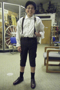 Nolan Patin, 13, is shown here dressed as a turn of the century newspaper boy for the Cedar Springs Historical Museum's recent Candlelight Tour. Photo courtesy of the CS Historical Museum.