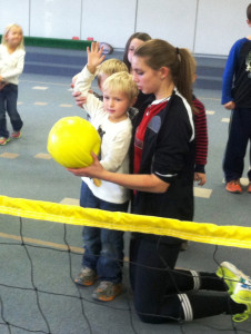 Campus Kids enjoy learning how to serve, set, and spike the ball from the Girl's Varsity Volleyball Team.