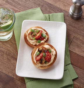 For a fresh take on traditional veggies, top mini bagels with a creamy sun-dried tomato and basil spread, such as the Creamy Mozzarella, Sun-Dried Tomato & Basil Flavor by The Laughing Cow, and add your favorite veggies (cherry tomatoes, roasted red pepper, mushrooms, etc.) for a delicious white pizza