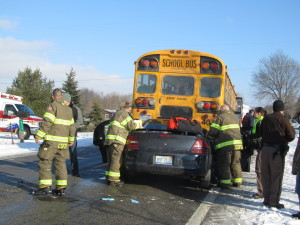 A car ran into the back of a Cedar Springs School bus this afternoon that had stopped to drop off a student. Post photo by J. Reed.