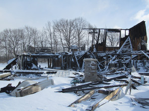 This home in Solon Township development is a total loss after a fire consumed it January 4. Photo by J. Reed.