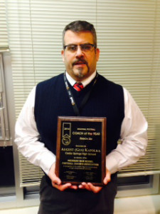 Coach August (Gus) Kapolka with his Coach of the year award.