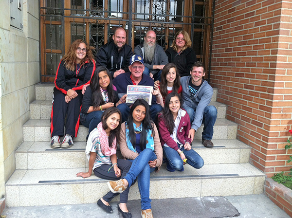A group from The Springs Church with children in Bogota, Colombia. Front row (L to R): Karen, Mayerly, Jennifer Middle row: Jeimy, Phil Moore, Nathaly, Shane Jewell Back row: Heather Ellsworth, Pastor Barry Briggs, Bill VanOss, Cathy VanOss