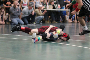 Luke Egan, from the 7/8 age group, pins last year's state champ.
