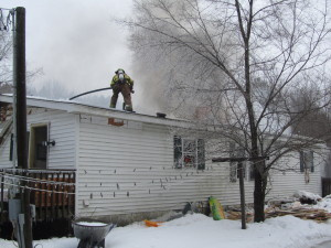 Firefighters were called to this home on Harvard Avenue in Oakfield Township shortly after 10 a.m. Tuesday. Post photo by J. Reed.