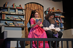 Alexis Lucarelli as Belle reading to Brandyn Kirchoff as the Beast.