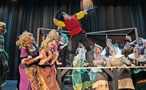 Remington Sawade as Gaston performing with many of the cast members.