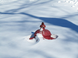 Snow often piles up around fire hydrants, especially after a snowstorm. Post photo by J. Reed.