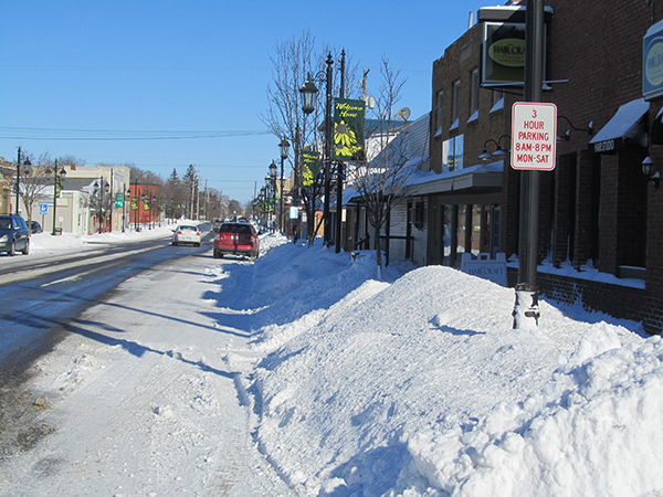 Snow piled up on Main Street on Monday after Sunday's storm. Post photo by J. Reed.