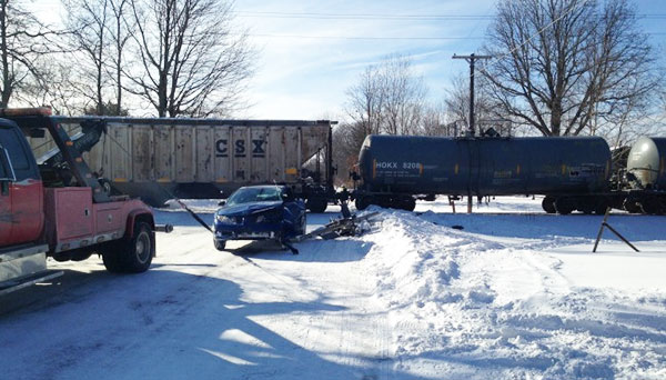 This Pontiac Sunfire is towed away after sliding into the path of a freight train near Sparta. Photo courtesy of WOODTV.com.