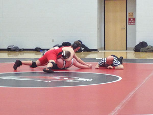 8th grader Cody McHenry at the Allendale invitational. Photo by Colleen White