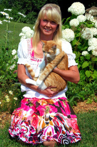 Amy Hansen with her pet cat, Cricket. Courtesy photo.