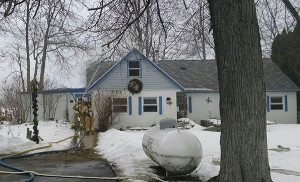 A home on Nugent was the scene of a fire Tuesday afternoon. Courtesy photo by Oliver Johnson.