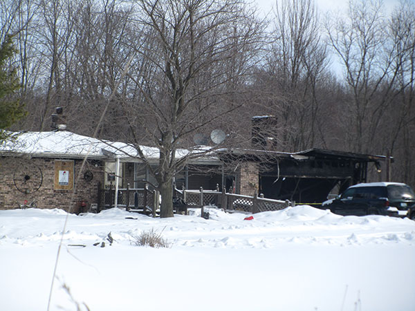This home on Algoma was damaged in an early morning fire on Monday, March 2. Post photo by J. Reed.