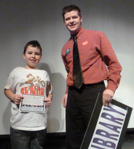 Craig Bruno (right), Branch Manager of the KDL Sand Lake/Nelson Township Library, with one of the prize winners from the first grade library card drive. Courtesy photo.