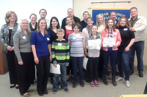 Students, parents, teachers, and principals involved in the Rotary 4-way test essay contest. Courtesy photo.