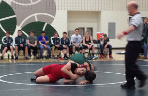 Red Hawk Allexis Gonzales (8th grade) grapples with her opponent. Photo by Colleen White.