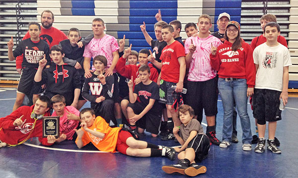 The Cedar Springs Middle School wrestling team with the Blue Division Plaque. Photo provided by Colleen White.