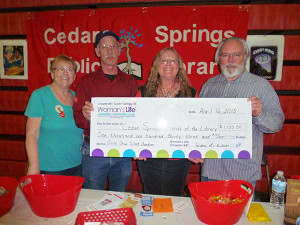 Woman's Life Cedar Springs Chapter 841 recently made a contribution toward the new Library Building Fund with proceeds from the recent quilt show.