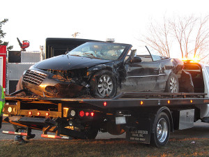Damage to Allen's black Chrysler Sebring convertible can be seen here