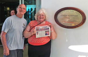 Bruce and Myrna Chapman pose with The Post aboard the Legend of the Seas.