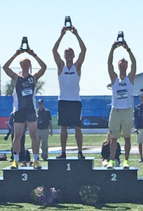 Justin Balczak (center) on winner's stand. Photo courtesy Jeff Myers.