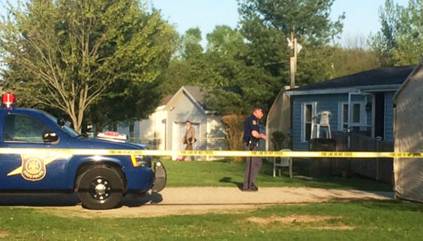Police at the scene of a homicide in Ensley Township. Photo courtesy of woodtv.com.