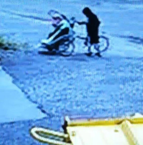 This photo shows the suspect taking the bike. Courtesy photo.