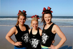 (L to R) Brittani Tozer, Heather Howard, and Amber Dunham are part of the Davenport University Cheer Team, which won national championships in both Competitive cheer and Stunt this spring.