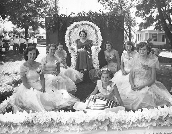 Pictured is the first Sand Lake Village Queen, Donna Shick, in 1952. Her court (L to R) Nancy Bergman, Marilyn Bergman, Mildred Hadrick, Bernice Manley, Norma Grimes, Joyce Kundee, and Sharon Robinson (crown bearer).