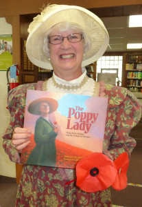 MaryAnn Yuncker dressed as The Poppy Lady for story time on May 27, at the Cedar Springs Library.