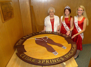 The Red Flannel Queen and court member presented the Ronny Merlington Memorial Medallion to his wife, Shirley Merlington