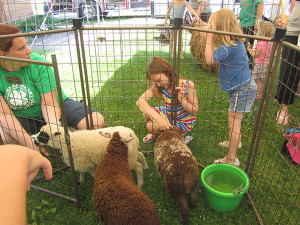 Kids enjoyed a petting zoo at the Cedar Springs Public Library's kick off program. Post photo by J. Reed.