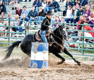 Linnay (Couturier) Mallory competing in Barrel Racing.