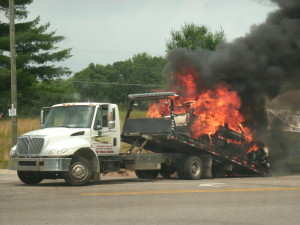 This SUV appears to have caught fire after being loaded on the tow truck. Photo courtesy of Gary Welch.