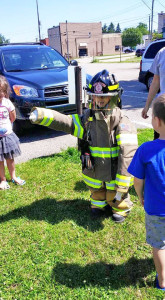 Preschoolers got to try on firefighter equipment. Courtesy photo.